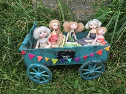 dolls in a wagon